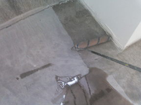 image of epoxy concrete floor paint being applied